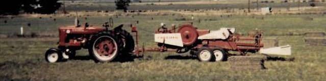 farm tractor pulling a hay bailer