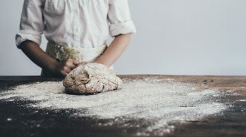 Bread baker with flour